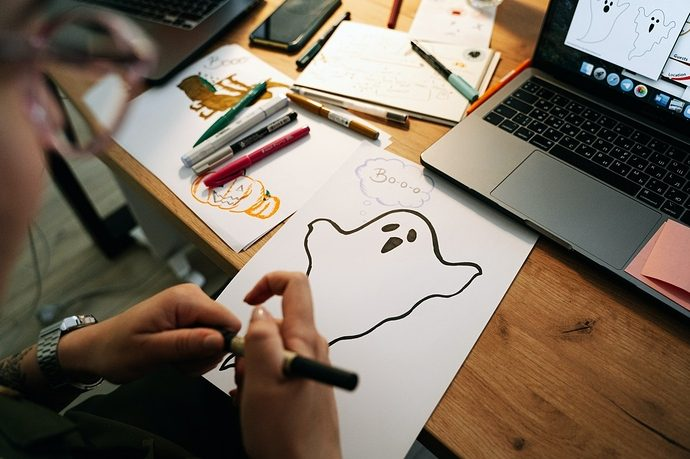 Person drawing a ghost